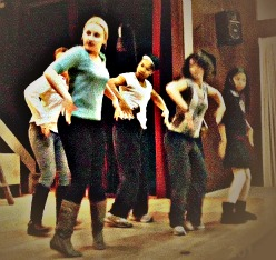Park Players - the cast of Urinetown practices a dance number